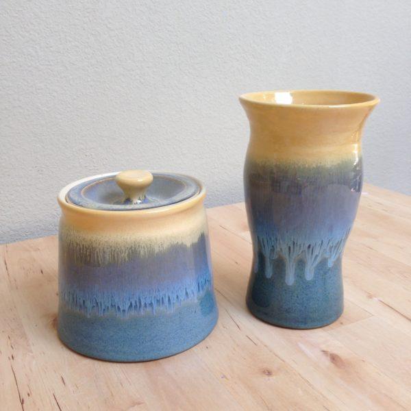Wheel thrown jar with lid, and vase.