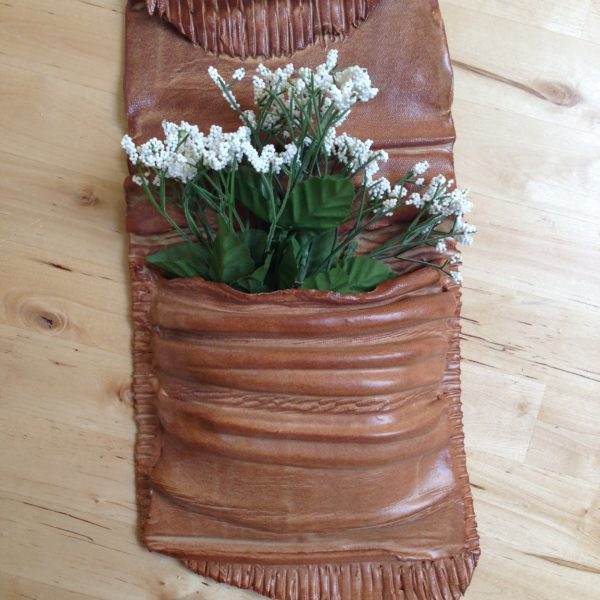 Garden wall pocket made from slabs of clay.